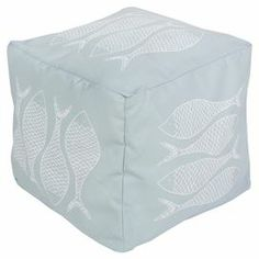 """Showcasing a fish motif in sky blue and ash gray, this eye-catching pouf lends nautical appeal to your living room or den.  Product: PoufConstruction Material: PolyesterColor: Sky blue and ash greyFeatures: Can be used indoor or outdoorsDimensions: 18"""" H x 18"""" W x 18"""" DCleaning and Care: With a dry cotton towel or white paper towel, blot out stain as much as possible. Scrape off any debris.  Blot area with a dry towel."""