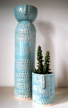 Atelier Stella. Tall lady vase and little succulent pot.