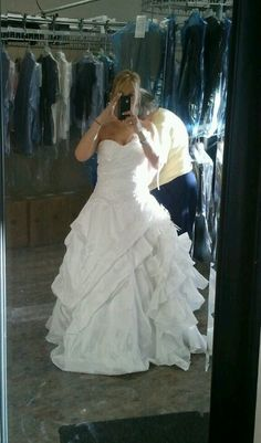Getting my dress altered at Elvira's :)