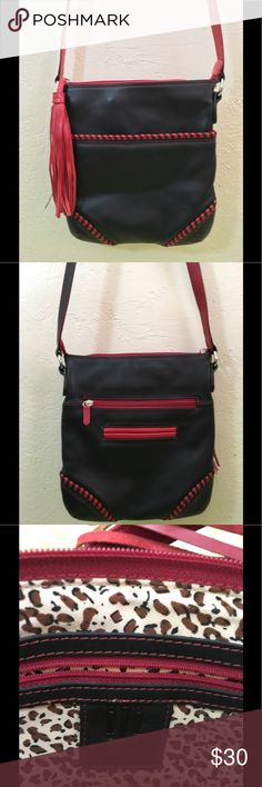 "ILI Black With Red trim red tassel cross body bag THIS ILI NEW YORK BAG IS CONSTRUCTED OF A NICE LIGHTWEIGHT BLACK LEATHER WITH RED LEATHER LACING AND TRIM AND A LARGE RED LEATHER TASSEL PULL.  IT FEATURES TWO POCKETS ON THE BACK AS WELL AS INSIDE.  NO SIGNS OF WEAR, THIS BAG LOOKS BRAND NEW.  IT HAS A LONG ADJUSTABLE 24"" CROSSBODY STRAP.  PLEASE LOOK AT EVERY PICTURE FOR A VISUAL DESCRIPTION. ILI Bags Crossbody Bags"
