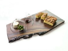 "Cheese Board  Materials: Natural Live Edge Wood Slab & Clear Glass  Dimensions:  Small: (1 lid) around 14"" x 9""  Large: (2 lids) around 20"" x 11""  Miniature cloche covers nest onto a hand worked, natural wood platter. Each piece is one of a kind and unique in character. Dimensions vary greatly due to the unique nature of wood slab.  *Stinky Cheese not included"