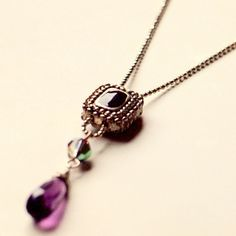 Long pendant necklace with bali style enameled square metal beads and amethyst briolette