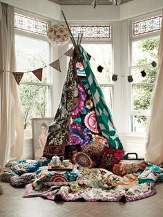 Thinking - Children den made from different colours/patterns of material (patchwork effect)