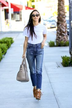 Cara Santana puts her best foot forward in this season's must-have high-waisted denim by 3x1.    - HarpersBAZAAR.com