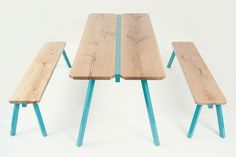 A strong base of lacquered steel legs supports the wood table top in natural solid oak.