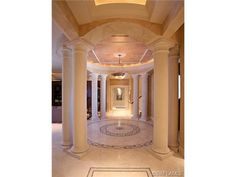 Grand foyer with columns - chandelier - marble in lay