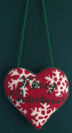 Merry Christmas Needlepoint Heart by Kirk & Bradley. Finished as a door hanger. Photo- needlepoint.com