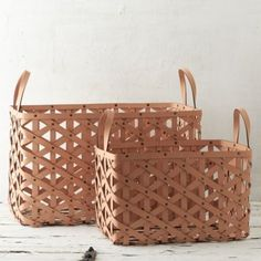"""Designed and crafted exclusively for terrain, this diamond-weave leather basket with grommet details offers a luxurious and practical solution to storage around the house.- A terrain exclusive- Leather, metal grommets- Wipe clean with damp cloth- ImportedSmall: 17.5""""H, 19""""W, 12.5""""LLarge: 22""""H, 26""""W, 16.5""""L"""