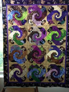 """from: Marie Stern: """"I did this quilt for my daughter-in-law for Christmas. She loves dogs and recently lost her basset hound Riley to cancer. He is featured in each square."""""""