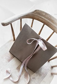 Simple muted coloured satin ribbon tied to brown paper