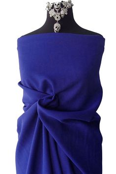 55% polyester 45% wool crepe georgette fabric in a dark cobalt blue This fabric is suitable for dress, suit, skirt. it drapes well and pleats well. Has body not flimsy at all, high end wool crepe. Made in Germany by Van Delden.  Width is 150cm Price is per meter  Order over one meter will be a continuous piece.