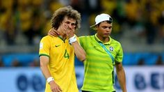 David Luiz (L) of Brazil is consoled by Thiago Silva during the 2014 FIFA World Cup Brazil Semi Final match between Brazil and Germany
