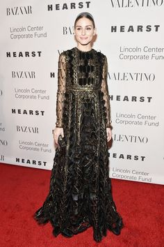 Olivia Palermo wears a Valentino gown with sheer, fringe and metallic accents.