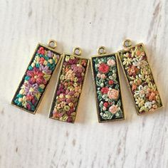 I might be totally obsessed with these new pendants. Silk Ribbon Embroidery, Embroidery Jewelry, Floral Embroidery, Cross Stitch Embroidery, Embroidery Patterns, Hand Embroidery, Textile Jewelry, Fabric Jewelry, Jewellery