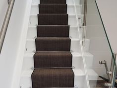 Brown Carpet Runner Installation With Stair Rods