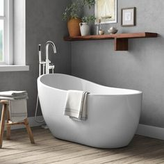 This bathtub is just right for relaxing with a good book after a busy day, or bathtime for the kids with rubber duckies and plenty of bubbles. It's crafted from acrylic and fiberglass in a white finish that's easy to match with your current bathroom decor – no remodel necessary. It comes with overflow drain hardware in your choice of finishes, so you can find the one that's just right. This slipper tub strikes a clean-lined silhouette with one raised side that you can lean against. Plus, the bot Tub Shower Combo, Shower Tub, Shower Tiles, Small Tub, Small Soaking Tub, Small Baths, Bathroom Inspiration, Bathroom Ideas, Bathroom Updates