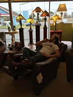 A Griffith Furniture salesman hard at work testing out the merchandise!