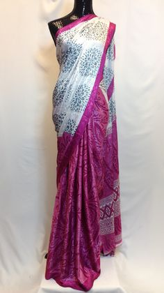 Stylish and gorgeous pearl white and pink self printed saree with contrasr gray motifs print makes this indian apparel to die for. High in demand due to its crepe like texture.This half & half saree g