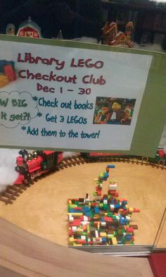 """Library Lego Checkout Club"" - such a cool idea! Everytime a child checks out books, they get to add 3 legos to a tower in the children's room. --> might be a great addition to summer reading.for SRC IF THERE IS NO LEGO Middle School Libraries, Elementary School Library, Elementary Library Decorations, School Library Decor, Kindergarten Library, Library Book Displays, Library Books, Reading Display, Library Week"