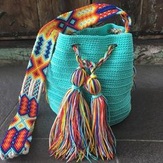 Mayan Morral Bag tassel by Otomiartesanal. Bracelets Wrap En Cuir, Bracelet Wrap, Bracelet Cuir, Embroidery Techniques, Bago, Primary Colors, Hand Knitting, Bucket Bag, Swatch
