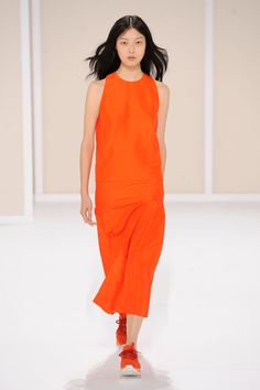 Racerback tank top with H pleats and skirt with inverted pleats in carnelian shantung silk, trainers in carnelian technical canvas and suede goatskin