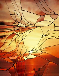 New York artist Bing Wright has a clever way of creating something simple and visually striking. For his latest series Broken Mirror/Evening Skies, he has photographed various sunset scenes in shattered mirrors, resulting in beautiful, understated images akin to stained glass windows.