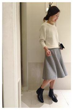 White top,light gray midi skirt,black short boots.