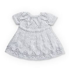Free knitting pattern for a baby dress with a fairy leaves stitch detail. Suitable for 6, 12 and 18 months.