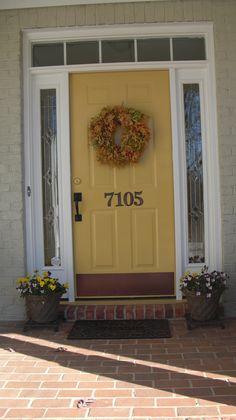 Love the honey yellow front door!