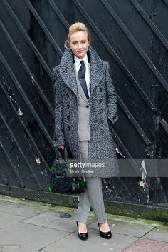 Group fashion editor for the Rake Magazine Sarah Ann Murray wears a Burberry Prossum coat, bespoke suit, Bally bag, LK Bennett shoes and Hermes tie day 3 of London Mens Fashion Week Autumn/Winter 2014, on January 08, 2014 in London, England.