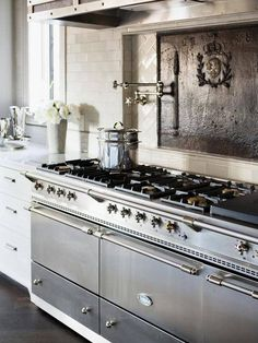 Kitchen Envy...the fabulous French Lacanche Range! Love the fire back too