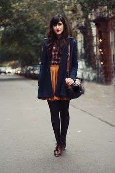 Autumn style...navy coat with flannel and mustard skirt...preppy fall style