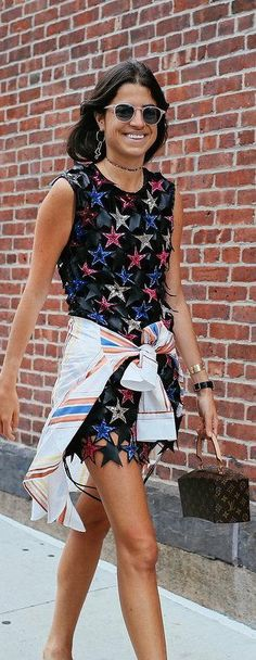 Leandra Medine in a Magda Butyrm dress and with a Louis Vuitton bag