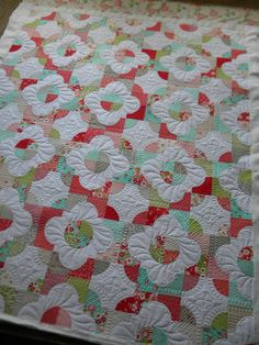 What a pretty floral spin on this drunkard's path quilt! The free-motion quilt pattern on top makes it competely unique.