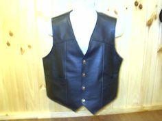 "Mens black leather vest. 2 front outside pockets. Fits 44"" chest. Reg. $245.00 SALE $185.00."