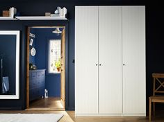 PAX white wardrobe with RISDAL white doors, HEMNES white mirror and blue chest of drawers