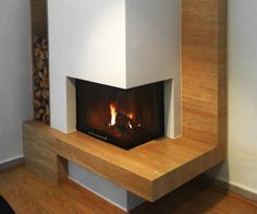 how to put a fireplace in the corner of a room Corner Gas Fireplace, Family Room Fireplace, Home Fireplace, Fireplace Design, Fireplace Ideas, Dutch House, Bungalow Renovation, Wood Burner, Family Room Design