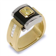 A Fancy Yellow Diamond set in Black Jade. Twisting a classic for that amazing man.