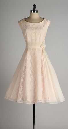 vintage 1950s blush lace and chiffon dress... love the touch of elegance that the sash and rose at the waist give it.