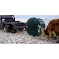 The Nifty Feed Dispenser allows one person to load, transport and dispense grain, cake feed, pellets or supplements to livestock under range feeding conditions. Round Bale Feeder, Livestock Trailers, Small Tractors, Beef Cattle, Living Off The Land, Hobby Farms, Farm Life, Nifty, Agriculture