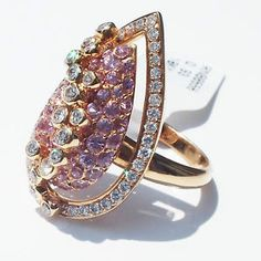 """This extravagant and magnificent ring is crafted in 18K solid stamped Rose Gold and contains .93 ct natural round diamonds and 1.85 ct natural round pink #Sapphires. The pear shaped center is adorned with 46 pink sapphires pave set and covered by scattered 16 diamonds set in bezels. The #Diamonds are G in color (near colorless) and VS2-SI1 in clarity (very slightly included) high quality. Excellent cut, Ring size: 7, weight: 8.73 grams, """"750"""" for 18K gold hallmark. $2,675"""