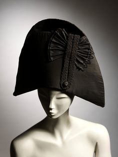 British & French Bicorn Hats (Circa 1800) Man's bicorne hat in black silk, trimmed with a silk button, black silk braid and a pleated silk cockade. During the Georgian Era, bicorn hats were not just for Royal Navy officers fighting Napoleon. They were a popular and fashionable accessory for the man about town. However, by the beginning of the 1800s they were relegated mainly to the realm of formal wear in civilian life. By 1810 completely replaced by the top hat.
