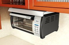 BLACK+DECKER Space Maker Digital Toaster Oven, Stainless Steel/Black The return of a classic. The new Spacemaker Toaster oven responds to thousand of requests Under Counter Toaster Oven, Toaster Ovens, Cheap Energy, Stainless Steel Toaster, Kitchen Oven, Condo Kitchen, Kitchen Stuff, Houses