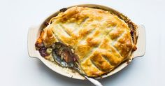 Layer Thanksgiving leftovers and top with puff pastry for a perfect potpie.