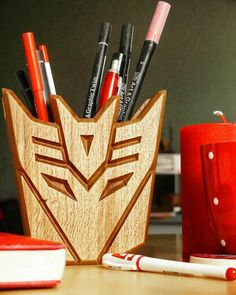 "Polubienia: 27, komentarze: 1 – CARPINTERO (@carpintero_decor) na Instagramie: ""#carpinterodecor #transformers #decepticons #megatron #woodworking #woodentoys #woodenholder…"" Transformers Decepticons, Transformers Prime, Cnc Router Table, Diy Wood Stove, Cool Wood Projects, Wood Creations, Office Accessories, Box Art, Crafts To Make"