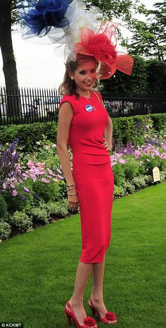 Patriotic: A lady arrives in a chic red, white and blue hat and a crimson dress...