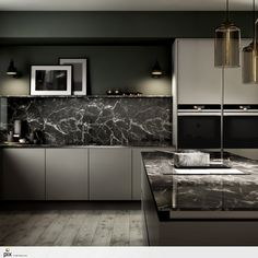 Marble is king! The matt grey kitchen with the handless door profile sits perfectly with the think marble worktop with smoked marble splashback. The deep green walls, ash wood floor and smoked glass pendants keep the interior design on trend