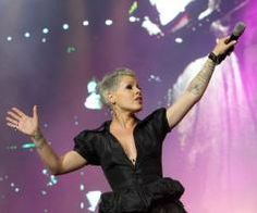 With true talent in both vocals and writing (and acrobatics...), P!nk brings a complex mix of frills and grit, fun and pain to her art. Much more than a pretty face, P!nk sends the message that it's okay to be exactly who you are, but to always let others live their truth, too. Pink In Concert, Concert Tickets For Sale, One Last Kiss, Pink Official, Top 10 Hits, American Tours, My Rock, Music Is Life, My Music