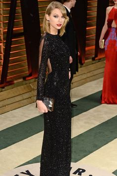 Taylor Swift put her new bob to work on the red carpet with a side-swept 'do and a sparkly black dress by Julien Macdonald.