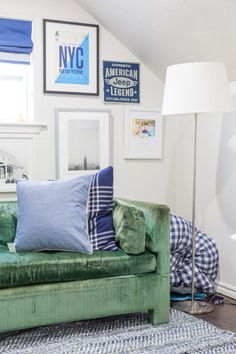 Tween boys bedroom and lounge space with a mix of vintage furniture and masculine textiles - gallery wall with travel inspired photography and prints - white paint colors and introducing color - www.pencilshaving... #oneroomchallenge #whitepaint #paintcolors #artwork #gallerywall #pencilshavingsstudio #romanshades #tweenbedroom #teenbedroom #teenhangout #boysbedroom #bigkidroom #vintagefurniture #velvetsofa #diy #serenaandlily #ragrug #naturaltexture #customwindowtreatment